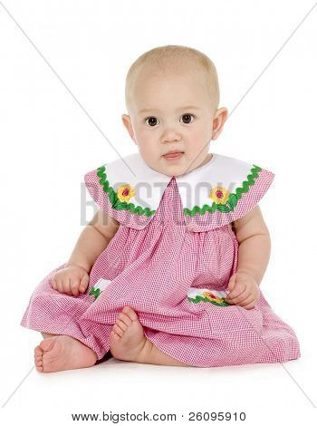 10 month old barefoot baby girl in dress. Full body over white.