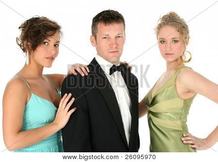 Young group, one man and two women, in formals over white.