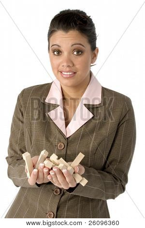 Hispanic business woman with wooden puzzle pieces in hand and frustrated expression.