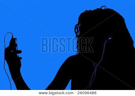 Silhouette in blue and black of teen with digital video player