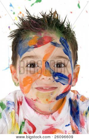 Beautiful toddler boy covered in bright paint.
