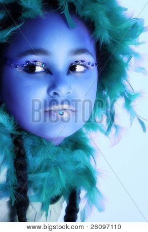 Beautiful ten year old African American girl in artistic makeup.
