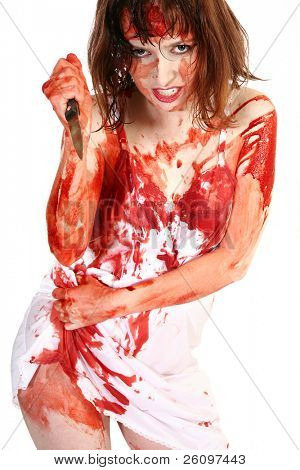 Thirty-five year old woman covered in blood holding knife.