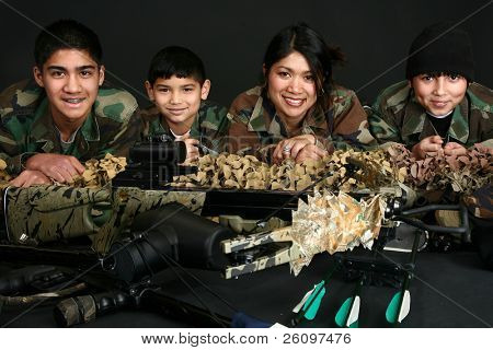 Beautiful Filipino woman and her three sons in camo and hunting gear.
