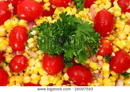 Grilled Corn Salad background.  Tomato, corn, parsley, onion.