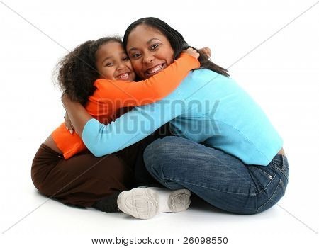 African American Mother and Daughter hugging over white.