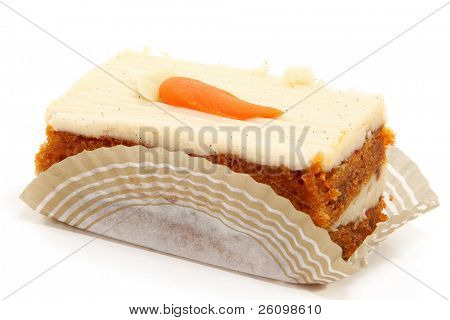Piece of carrot cake on bakery serving paper shot over white.