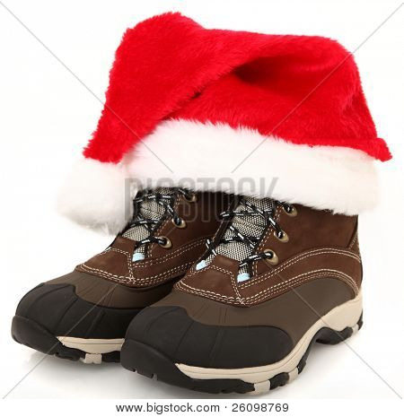Woman's tie up (lace up) weather proof snow boots with santa hat.