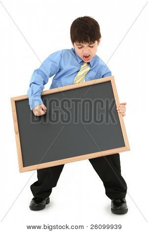 Adorable seven year old french american boy in dress clothes playing air guiltar with a blank chalkboard over white background.