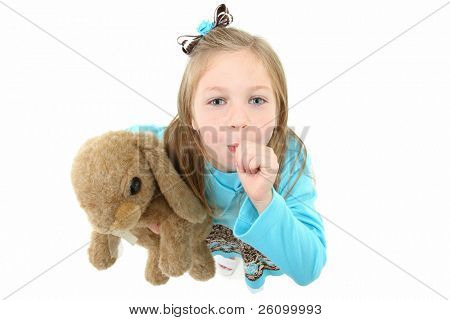 Above view of adorable five year old american girl sucking thumb over white background.