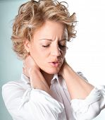 stock photo of human neck  - Woman with pain in her neck - JPG