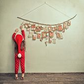Child In A Christmas Cap. Advent Calendar For Kids. poster