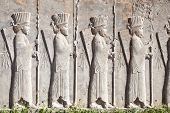 stock photo of xerxes  - Bass relief decoration in central part of Persepolis complex - JPG