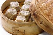Shumai dumplings in a bamboo basket