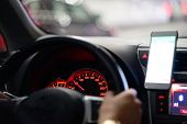Hands Of Man With A Steering Wheel, Driving A Car On A Smartphone Navigator. Photo Of A Man Driving  poster
