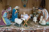 Figure Of Birth Of Jesus In Farm Shed.christmas Nativity Scene With Three Wise Men Presenting Gifts  poster