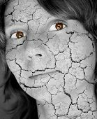 Woman face like cracked earth