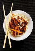Chinese honey glazed pork meat with peanuts and vegetables