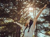 Free Happy Woman In Forest Enjoying Nature. Natural Beauty Girl Outdoor In Freedom Enjoyment Concept poster