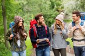 travel, tourism, hiking and people concept - group of happy friends or travelers with backpacks and  poster