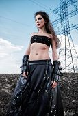 Informal Fashion: The Attractive Slim Young Goth Girl Dressed In Black Leather Skirt And Gloves. Out poster