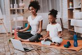 Mother And Little Girl Training Together. Young Mother And Young Girl. Traing Together. Relaxation W poster