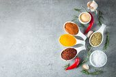 Spices In Wooden Spoon. Herbs. Curry, Saffron, Turmeric, Rosemary, Cinnamon, Garlic, Pepper, Anise O poster