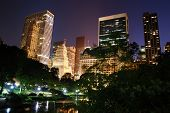 pic of new york night  - New York City Central Park at night with Manhattan skyscrapers lit with light - JPG