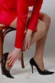 pic of duplex  - beautiful woman feeling pain in her right foot - JPG