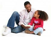 image of father daughter  - African American father and daughter reading child - JPG
