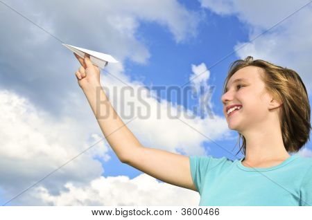 Young Girl Holding Paper Airplane
