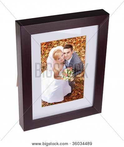 Photo Frame With Picture Of Happy Couple On Their Weding Day