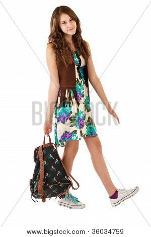 Teenage Girl In Flowered Dress With Backpack