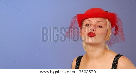 Blond PinUp In Hat Blowing A Kiss