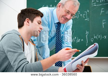 Student With A Teacher In Classroom