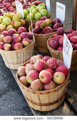 Luscious Apples In Bushel Baskets At A Farmers Market