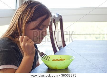 Young Girl Unimpressed With Her Food