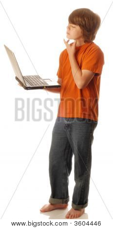 Teen Boy With Computer Thinking