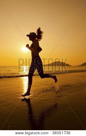 Woman jogging on the beach
