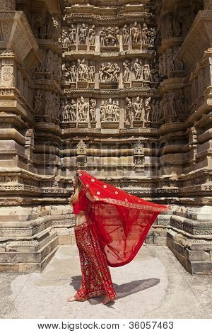 Red sari blowing in the wind at khajuraho.