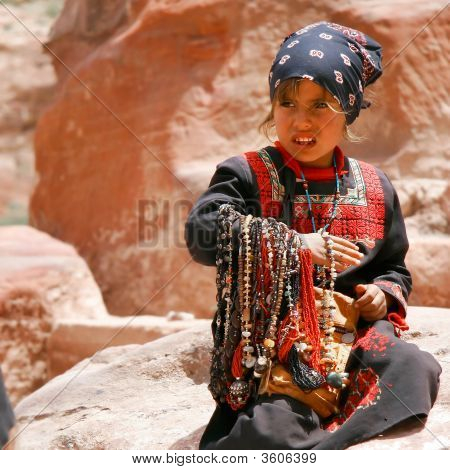 Young Asian Girl Selling Beads