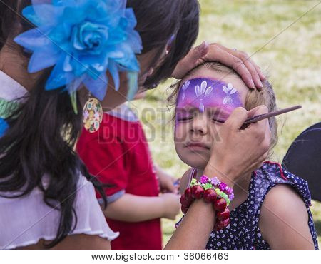 Make Up Artist Painting Young Girls Face