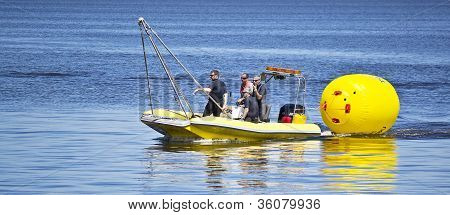 employees Of The Rescue Team Arranges Buoys.