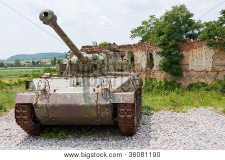 Tank In Front Of Broken House