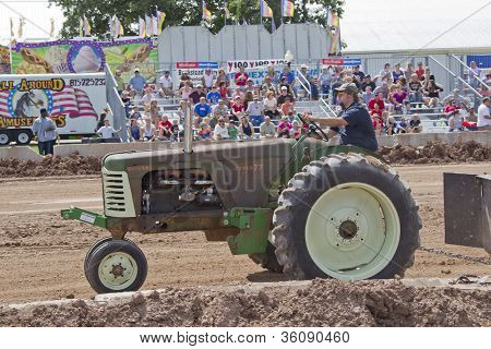 An Old Green Oliver Super 77 Tractor