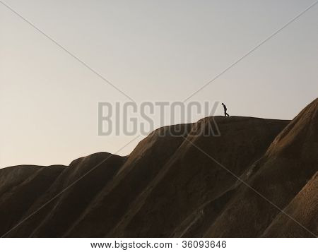 Man Walking Down A Hill