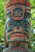 picture of indian totem pole  - Wooden totem pole monumental sculpture carved from large tree - JPG