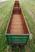 image of boxcar  - Empty boxcar on the railroad transportation green - JPG