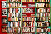foto of book-shelf  - Big shelf with lot of colorful books - JPG