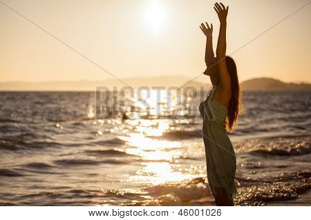 Happy woman and a beautiful sunset